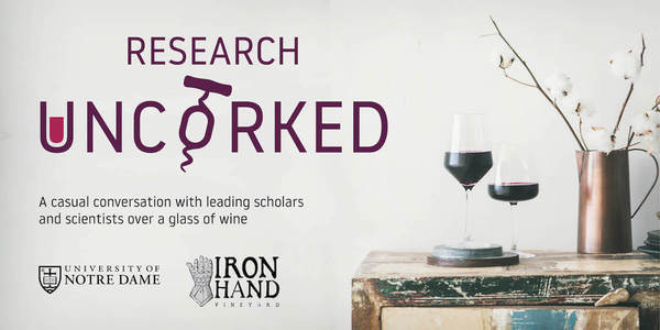 Research Uncorked logo featuring a U filled with red wine and an O with a corkscrew through it