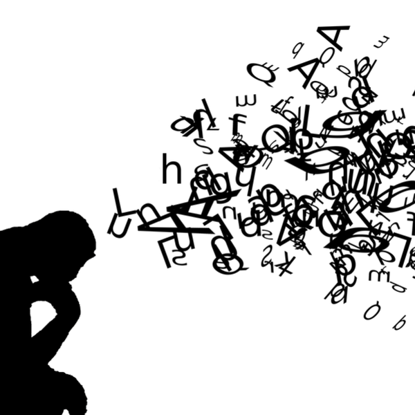 silhouette of a person thinking with a cloud of letters and symbols above them